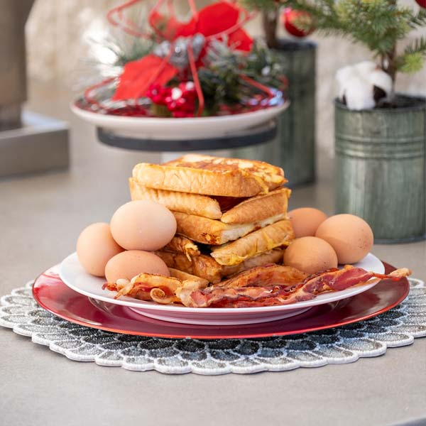 Big breakfast of eggs and a sandwich to celbrate Christmas.