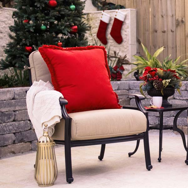 Cozy outdoor seating decked out in holiday hues - red.