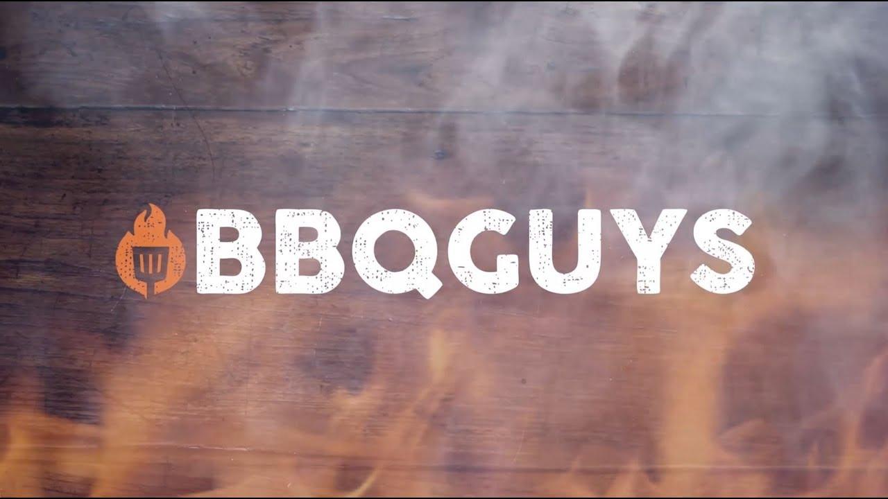 BBQGuys logo against woodgrain and smoke
