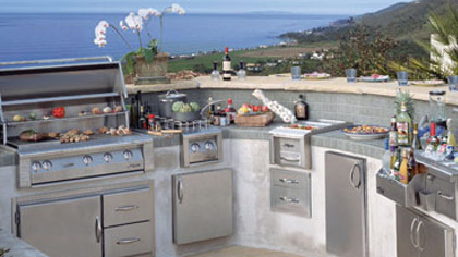 Beachside outdoor kitchen made of concrete and stainless steel.